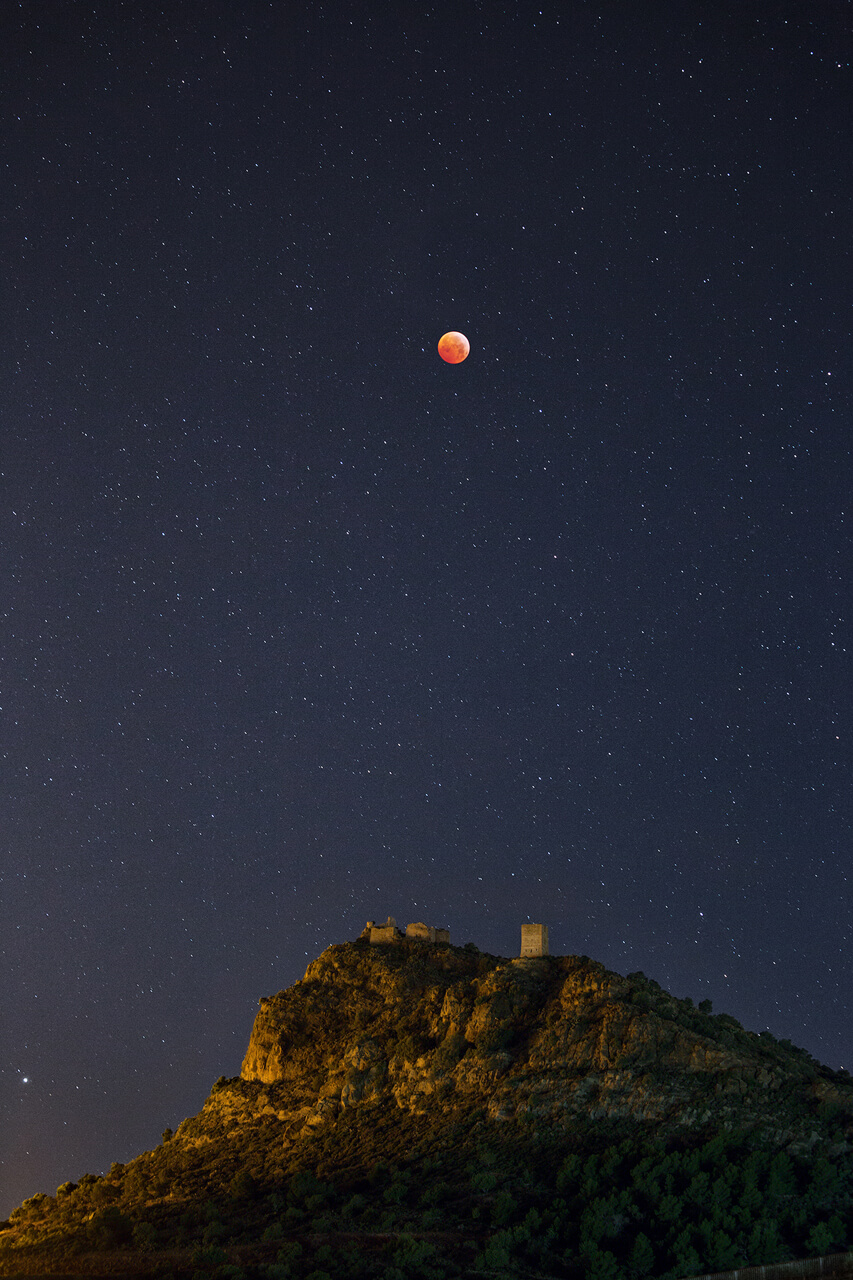 Castle and full moon eclipse