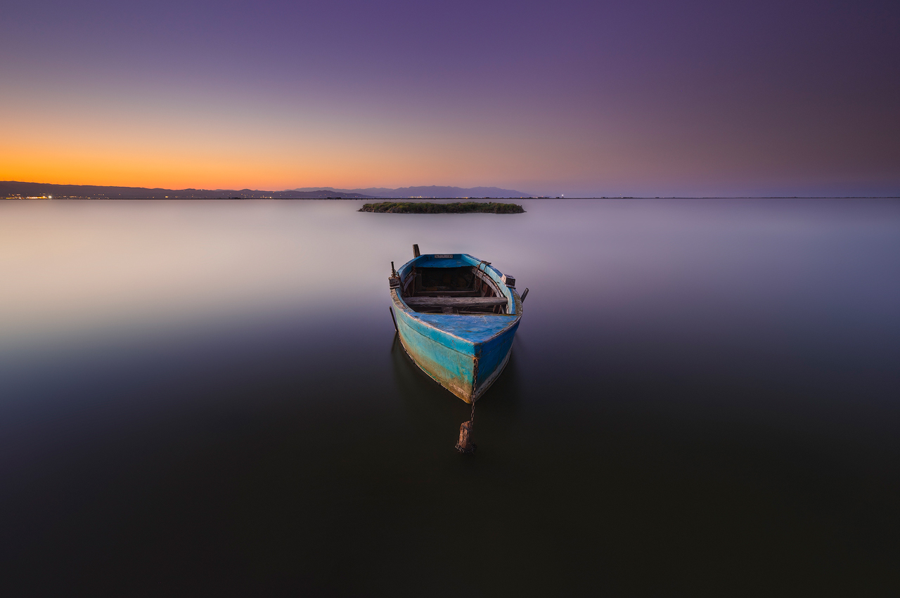 Delta del ebro boat at sunset