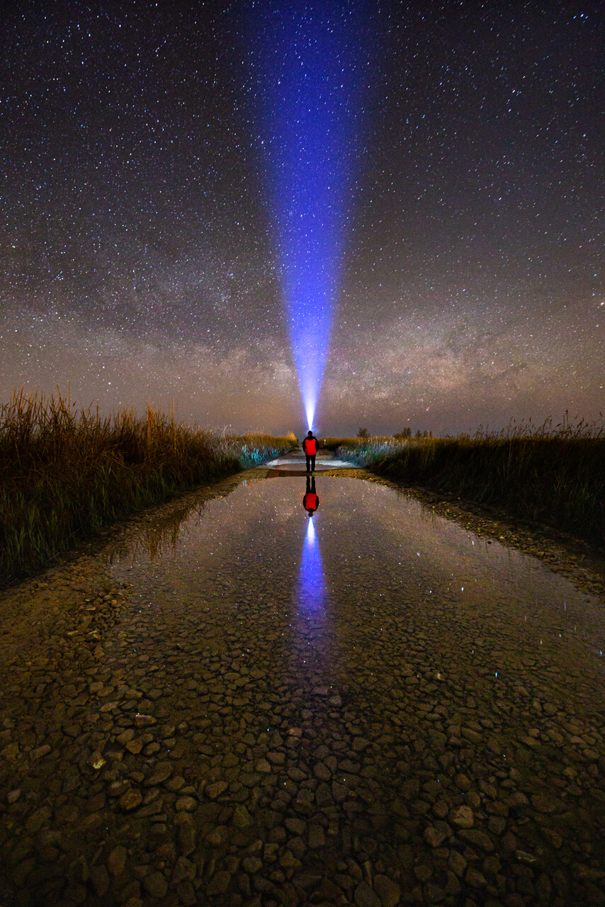 Milky Way reflected with person